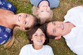 Cheerful Family Lying In Circle On The Grass Royalty Free Stock Photos - 13258848