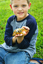 Little Boy Holding A Frog Royalty Free Stock Photography - 13321027