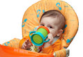 Kid Drinks Juice From The Drinking Bowl Stock Images - 13327864