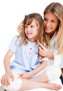 Charming Woman Brushing Her Daugther S Hair Stock Image - 13341691