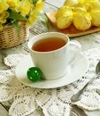 Easter Composition Of Tea Cup, Flowers And Eggs Stock Photos - 13387633