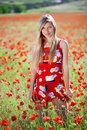 Girl In Poppy Field Royalty Free Stock Photography - 13501717