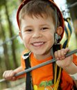 Little Boy Smiling In Adventure Park Stock Photography - 13505052
