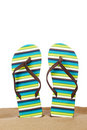 Flipflops On The Sand Royalty Free Stock Photo - 13538145