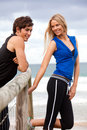 Smiling Young Couple By Fence At The Beach Stock Photography - 13562772