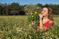 Beautiful Young Woman Standing In Blooming Meadow Stock Photo - 13567370
