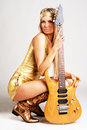 Golden Girl With Electric Guitar Stock Image - 13594061
