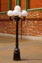 Antique Style Street Lamp In Front Of Brick Wall Royalty Free Stock Image - 13594456