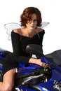 Brunette Girl On Motorcycle Black Dress And Wings Royalty Free Stock Photography - 1362607