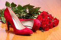 Pair Of Red Female Shoes And Bunch Of Red Roses Royalty Free Stock Photography - 13677577