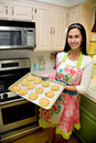 Pretty Woman In Kitchen Baking Cookies Stock Images - 13740804