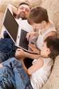 Father With Two Sons With Laptop Stock Images - 13747364