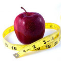 Red Apple And Tape Measure Stock Photography - 13782012