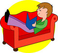Boy Reading On Couch Royalty Free Stock Photo - 1393665
