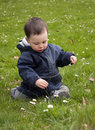 Child In Spring Grass Royalty Free Stock Photos - 13923408