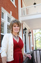 Attractive Woman On Porch Stock Photo - 13934380
