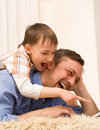 Father And Son Lying With Laptop Royalty Free Stock Photo - 14004115