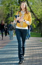 Yong Woman Walking In The Park Royalty Free Stock Photography - 14006967
