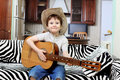 Boy With A Guitar Royalty Free Stock Photos - 14015068