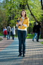 Yong Woman Walking In The Park Stock Photo - 14016590