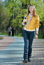 Yong Woman Walking In The Park Stock Photography - 14032042