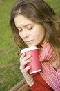Female In A Park Drinking Coffee Royalty Free Stock Photo - 14053125