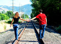 Couple Holding Hands On Railroad Royalty Free Stock Photography - 14087677