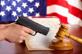 Hand With Gun And Judges Gavel Royalty Free Stock Photography - 14092047