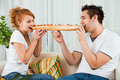 Beauty Girl And A Handsome Boy Eating Sandwich Stock Photos - 14109893
