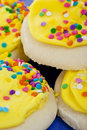 Yellow Frosted Sugar Cookies With Sprinkles Stock Photos - 14114703