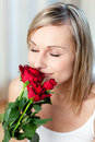 Beautiful Woman Smelling Roses Stock Images - 14142014
