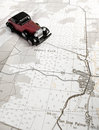 Vintage Model Car And Map Royalty Free Stock Image - 14153936