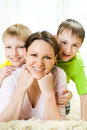 Mother With Her Two Children Royalty Free Stock Images - 14165269