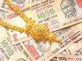 Gold And Indian Currency Stock Photography - 14167592