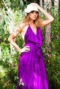 Young Woman In A Purple Dress Outdoors Stock Photography - 14277542