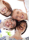 Circle Of Happy Friends With Their Heads Together Stock Photos - 14311303
