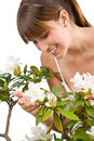 Gardening - Woman With Rhododendron Flower Royalty Free Stock Image - 14352876