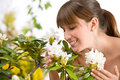 Woman Smelling Blossom Of Rhododendron Flower Stock Photo - 14352890
