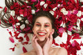 Smiling Woman With Flowers Stock Image - 14382391