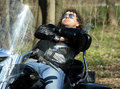 Fashionable Biker Relax Sitting On His Motorcycle Royalty Free Stock Photos - 14409508