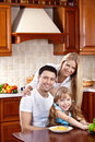 Family In Kitchen Stock Photography - 14415912