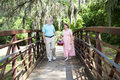 Seniors Strolling In Park Royalty Free Stock Photography - 14457157