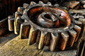 Antique Wood Machinery Wheel On Old Wooden Bench  Royalty Free Stock Photo - 14546195