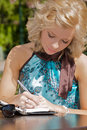 Woman Writing In A Notebook Royalty Free Stock Photography - 14565627