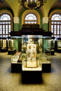 Museum Exhibits Of Ancient Relics In Glass Cases Stock Photography - 14577462