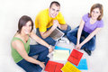 Students On The Floor With Notebooks Royalty Free Stock Images - 14586299