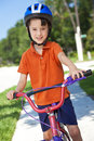 Young Boy Child Cycling On His Bicycle Stock Photography - 14616232