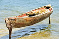 Wooden Canoe Moored On Posts Royalty Free Stock Image - 14635686