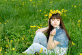 Girl Sitting Among Dandelions Royalty Free Stock Photos - 14642718