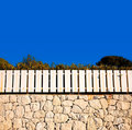 White Fence On Stone Wall Royalty Free Stock Photography - 1475187